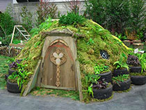 the Hobbit Door featured in the Abundant Nature Garden